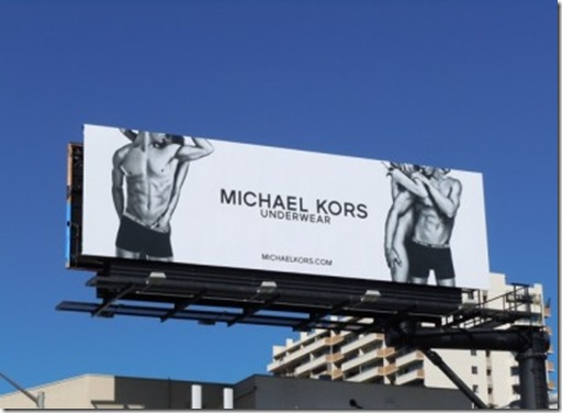 michaelkors-underwear-model-billboard-across the street from the Manhunt billboard with lamar