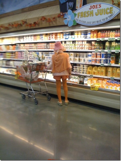 orange lady buying orange juice in trader joes