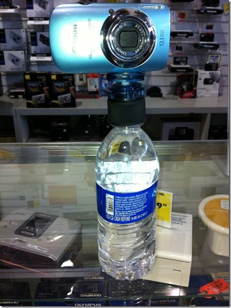 tripod with a water bottle