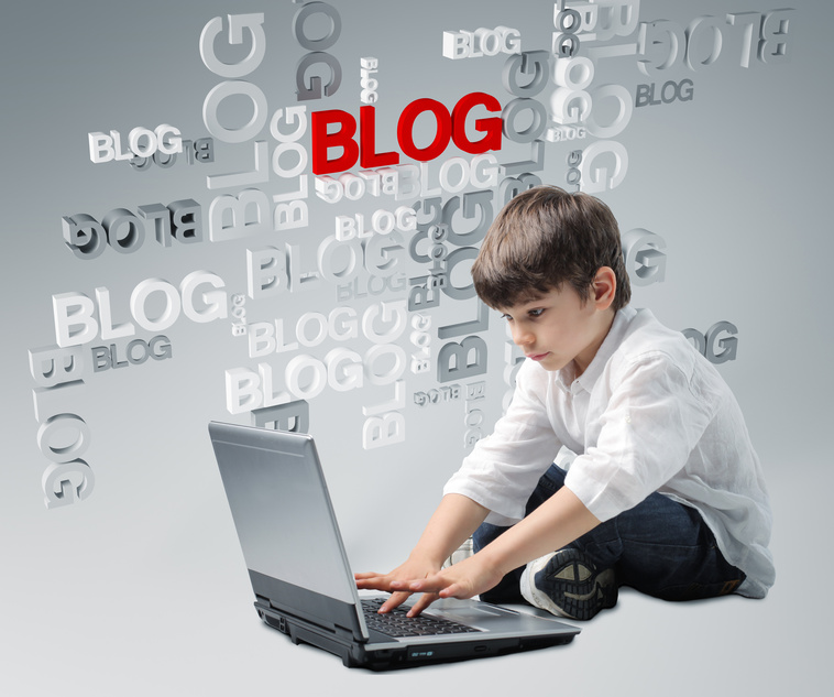 kid usingg computer with word blog