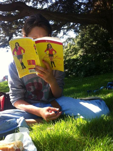 Jane Reading Pretty Little Liars under a tree in San Francisco